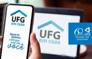"""Imagem de um computador e de um celular nas cores branca e azul com a mensagem """"Apesar da distância  UFG quer estar com você"""""""